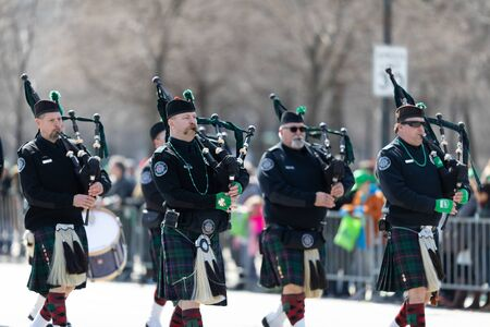 Chicago, Illinois, USA - March 16, 2019: St. Patricks Day Parade, The Band of Brothers Pipes And Drums performing at the parade Редакционное