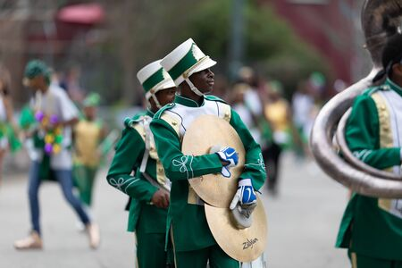 New Orleans, Louisiana, USA - February 23, 2019: Mardi Gras Parade, The Medard H Nelson Charter School, the Mighty Roadrunners, performing at the parade 新聞圖片