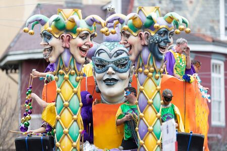 New Orleans, Louisiana, USA - February 23, 2019: Mardi Gras Parade, Float with Jester heads, going down the street at the parade Éditoriale