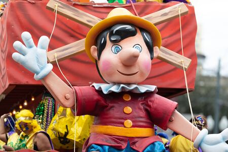 New Orleans, Louisiana, USA - February 23, 2019: Mardi Gras Parade, Float with a sculpture of Pinocchio at the mardi gras parade