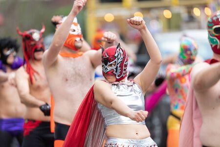 New Orleans, Louisiana, USA - February 23, 2019: Mardi Gras Parade, Members of El Lucha Krewe, Dancing at the Mardi Gras Parade