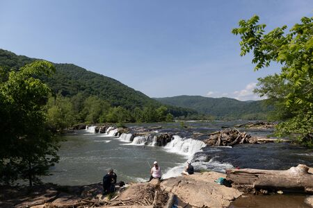 Shady Spring, West Virginia, USA: May 19, 2019, People Fishing at the Sandstone Falls, in the New River, during summer, located at Shady Spring, West Virginia, United States of America