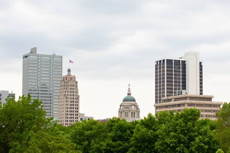 Fort Wayne, city in the state of Indiana, USA, the skyline emerges behind trees
