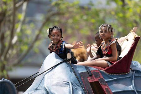 Cleveland, Ohio, USA - June 8, 2019: Parade the Circle, children riding an abstract rino during the parade