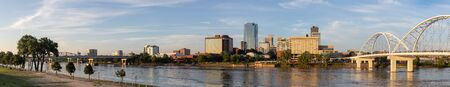 Little Rock the capital of Arkansas in the United States, as seen at dawn across the Arkansas River Stock Photo