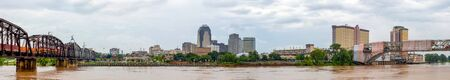 Shreveport, city in the state of Louisiana, United States, as seen across the Red River, during overcast and rain