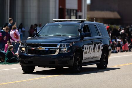 Benton Harbor, Michigan, USA - May 4, 2019: Blossomtime Festival Grand Floral Parade, Michigan police vehicles leading the start of the parade