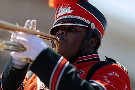 Benton Harbor, Michigan, USA - May 4, 2019: Blossomtime Festival Grand Floral Parade, Member of the Benton Harbor High School Tiger Marching Band playing the trumpet Redakční