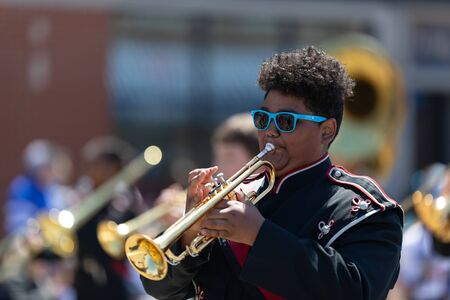 Benton Harbor, Michigan, USA - May 4, 2019: Blossomtime Festival Grand Floral Parade, Members of the EAU Claire High School Marching Band performing at the parade Editorial