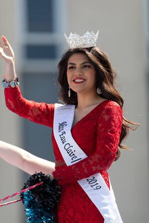 Benton Harbor, Michigan, USA - May 4, 2019: Blossomtime Festival Grand Floral Parade, Float carrying  Miss Eau Claire and her court during the parade Editorial