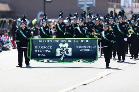 Benton Harbor, Michigan, USA - May 4, 2019: Blossomtime Festival Grand Floral Parade, Members of the Berrien Springs High School, performing during the parade 写真素材 - 130078327