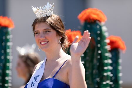 Benton Harbor, Michigan, USA - May 4, 2019: Blossomtime Festival Grand Floral Parade, Float carrying Miss Berrien Springs and her court during the parade 写真素材 - 130078359