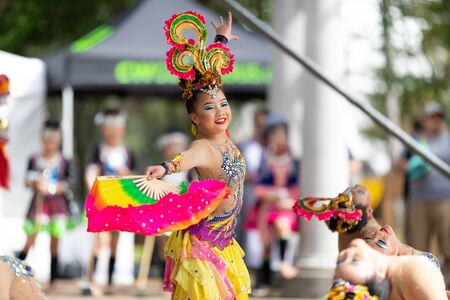 Columbus, Ohio, USA - May 26, 2019: Columbus Asian Festival, Young girls performing Hmong traditional dances, in the amphitheater at Franklin Park