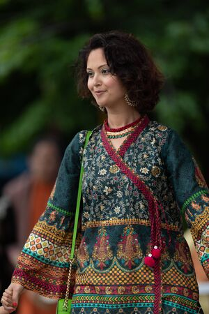 Grand Rapids, Michigan, USA - June 15, 2019: Asian Pacific Festival, Pakistani woman wearing traditional clothing at a fashion display  in the Rosa Parks Circle