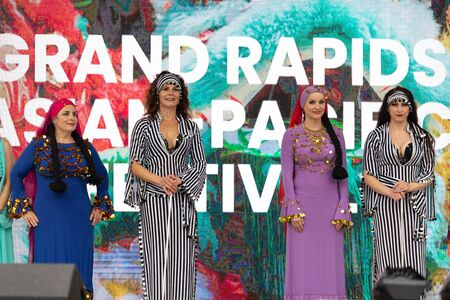 Grand Rapids, Michigan, USA - June 15, 2019: Asian Pacific Festival, Women wearing traditional Egyptian clothing performing traditional dance at the Rosa Parks Circle