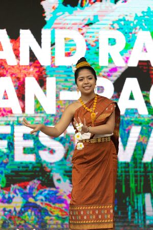 Grand Rapids, Michigan, USA - June 15, 2019: Asian Pacific Festival, thai dancer, wearing traditional clothing, performing a traditional dance at the Rosa Parks Circle