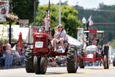 Buckhannon, West Virginia, USA - May 18, 2019: Strawberry Festival, Old Tractors being driven along Main Street during the parade