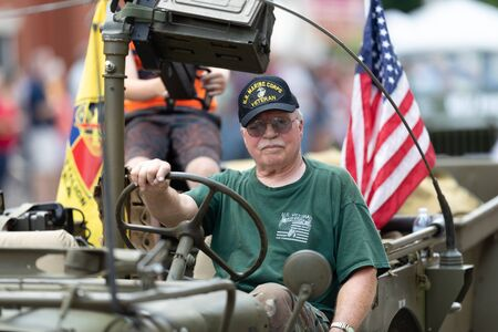 Buckhannon, West Virginia, USA - May 18, 2019: Strawberry Festival, Military veterans of the United States being driven on jeeps during the parade Editorial