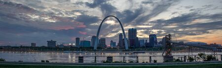 The City of St. Louis, in the state of Missouri, United States of America, as seen at Sunset across the Mississippi River Stock Photo