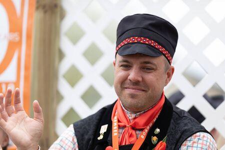 Holland, Michigan, USA - May 11, 2019: Tulip Time Parade, Man smiling and waving at people, wearing traditional dutch clothing during the parade