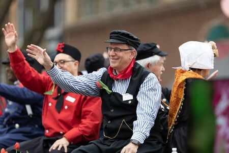 Holland, Michigan, USA - May 11, 2019: Tulip Time Parade, Men wearing traditional dutch clothing, riding on a float during the parade