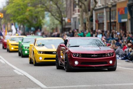 Holland, Michigan, USA - May 11, 2019: Tulip Time Parade, A group of Camaros going down the road during the parade