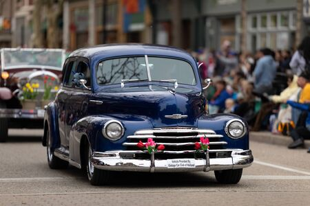 Holland, Michigan, USA - May 11, 2019: Tulip Time Parade, A Chevrolet, Fleet Master leading a group of classic cars during the parade
