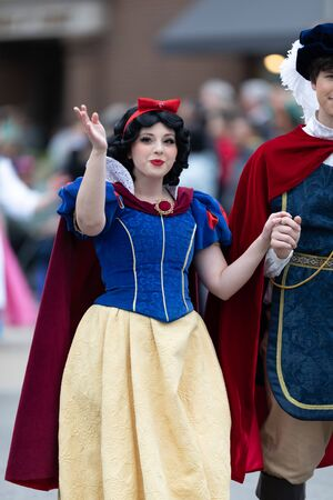 Holland, Michigan, USA - May 11, 2019: Tulip Time Parade, Woman dress up as Disney Character Snow White during the parade Editorial