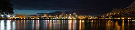 Peoria, in the state of Illinois, United States of America, at night, across the Illinois River Stock Photo