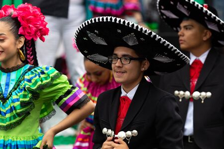 Chicago, Illinois, USA - September 8, 2019: 26th Street Mexican Independence Parade, Young mexican man wearing a traditional Mariachi outfit, smiling Editorial