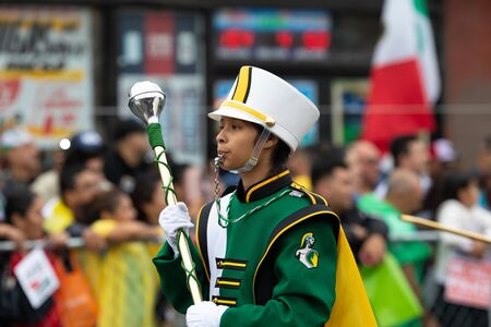 Chicago, Illinois, USA - September 8, 2019: 26th Street Mexican Independence Parade Members of The Trojan Band from Kelly High School, performing at the parade Editorial