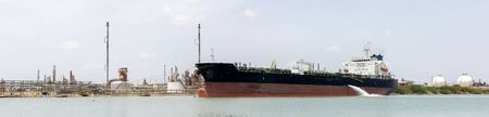 Oil Tanker at anchor, infront of oil refinery, Texas