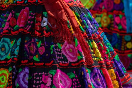Mexican traditional clothing, from a female dancer, close up