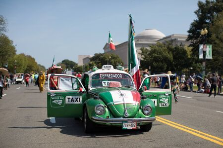 Washington DC, USA - September 21, 2019: The Fiesta DC, Mexican Beetle Taxi, carrying mexican flags during the parade 에디토리얼