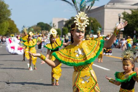 Washington DC, USA - September 21, 2019: The Fiesta DC, Colombian performing Chibchas culture traditional dances during the parade