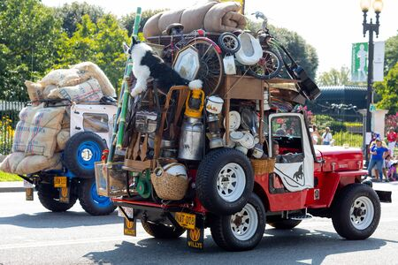 Washington DC, USA - September 21, 2019: The Fiesta DC, Willys jeeps, heavy loaded, going down constitution avenue, during the parade