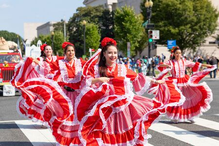 Washington DC, USA - September 21, 2019: The Fiesta DC, Colombian women wearing traditional clothing, performing Cumbia dance during the parade Editorial