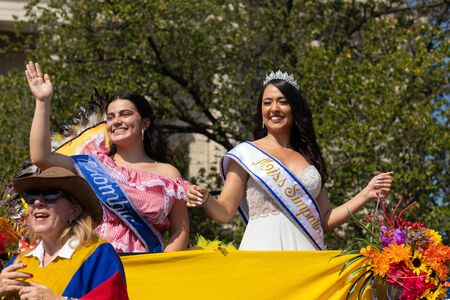 Washington DC, USA - September 21, 2019: The Fiesta DC, Colombian Beauty queen, on a float going down constitution avenue during the parade