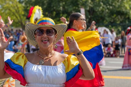 Washington DC, USA - September 21, 2019: The Fiesta DC, Colombian dancer wearing traditional clothing smiles and looks at the camera during the parade