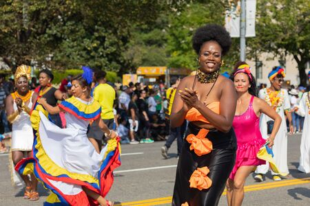 Washington DC, USA - September 21, 2019: The Fiesta DC, Colombian dancer wearing traditional african caribbean clothing, dancing during the parade