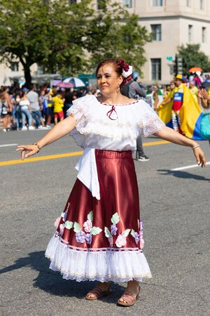 Washington DC, USA - September 21, 2019: The Fiesta DC, Colombian woman wearing traditional clothing performing dances during the parade