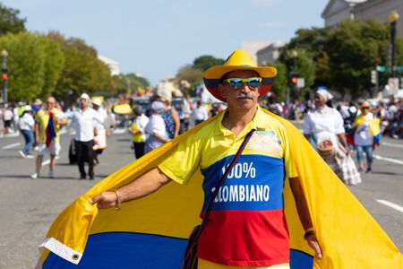 Washington DC, USA - September 21, 2019: The Fiesta DC, Colombian, holding his national flag, walking down constitution avenue during the parade Editorial