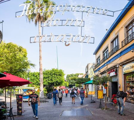 San Pedro Tlaquepaque, Jalisco, Mexico - November 23, 2019: Locals and Tourists exploring the restaurants and shops on Independencia Street