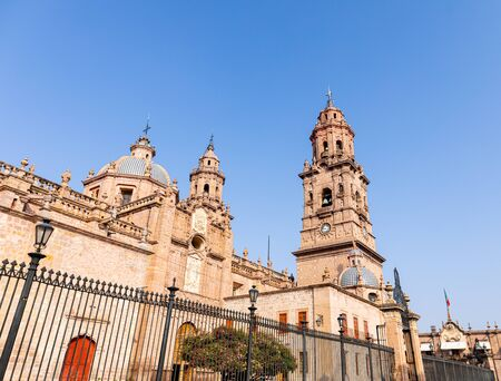 The towers of the Morelia Cathedral against a blue sky, in the Mexican state of Michoacan