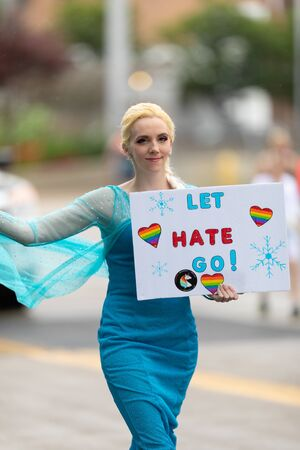 Cincinnati, Ohio, USA - June 22, 2019: The Cincinnati Pride Parade, person wearing a Elsa outfit, holding a sign that says let hate go