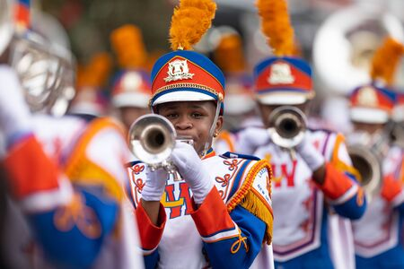 New Orleans, Louisiana, USA - November 30, 2019: Bayou Classic Parade, Members of the Andry-Walker High School Marching Band performing at the parade Editorial