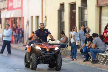 Matamoros, Tamaulipas, Mexico - November 20, 2019: The Mexican Revolution Day Parade, Member of Civil Protection, patroling the street of Matamoros during the parade