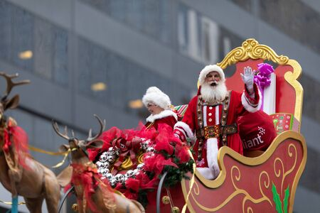 Houston, Texas, USA - November 28, 2019: H-E-B Thanksgiving Day Parade, Santa Claus and Miss Claus in their sleigh, waving at the spectators Editorial