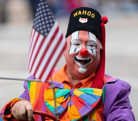 Houston, Texas, USA - November 28, 2019: H-E-B Thanksgiving Day Parade, Man dress up as a clown, driving a mini car on Milam street at the parade Editorial