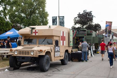 Indianapolis, Indiana, USA - August 16, 2019: National Guard Expo, an ambulance Humvee, among other military equipment being show to the civilian population Redactioneel